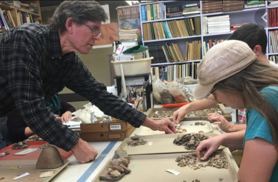 David Moore assists Warren Wilson College students in archaeology lab.
